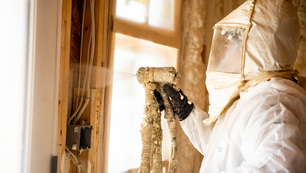 A spray foam contractor fills a wall with Accufoam.